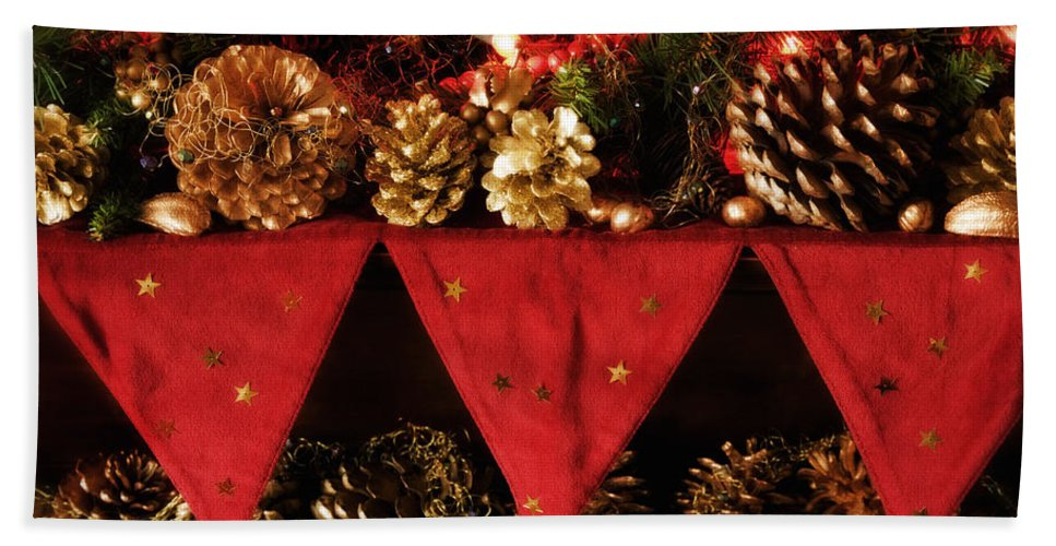 Christmas Bath Sheet featuring the photograph Christmas Decorations Of Garlands And Pine Cones by Mal Bray