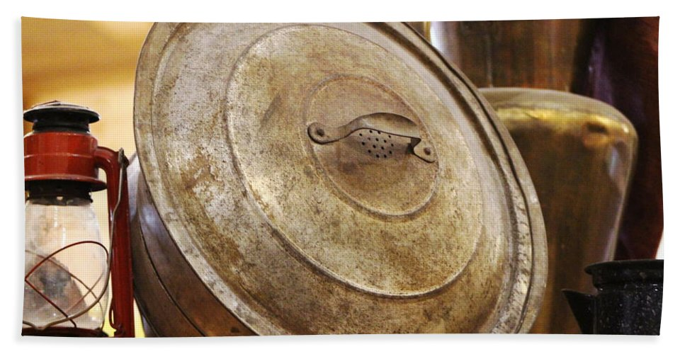 Hurricane Lamp Bath Towel featuring the photograph Closeup of Antique Pot and Hurricane Lantern by Colleen Cornelius