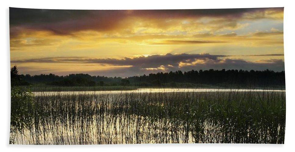 Cloud Bath Sheet featuring the photograph Cloudy Sunrise by Vadzim Kandratsenkau