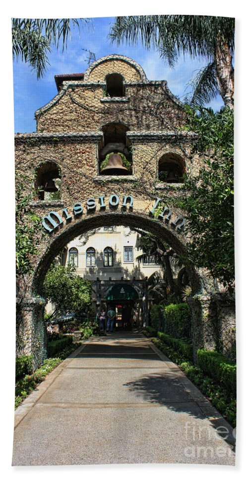 Mission Inn Hand Towel featuring the photograph Coach Entrance by Tommy Anderson
