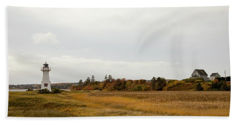 Ann Of Green Gable Scenic Drive Bath Sheet featuring the photograph Coastline Of Prince Edward Island, Canada With Lighhouse by Karen Foley