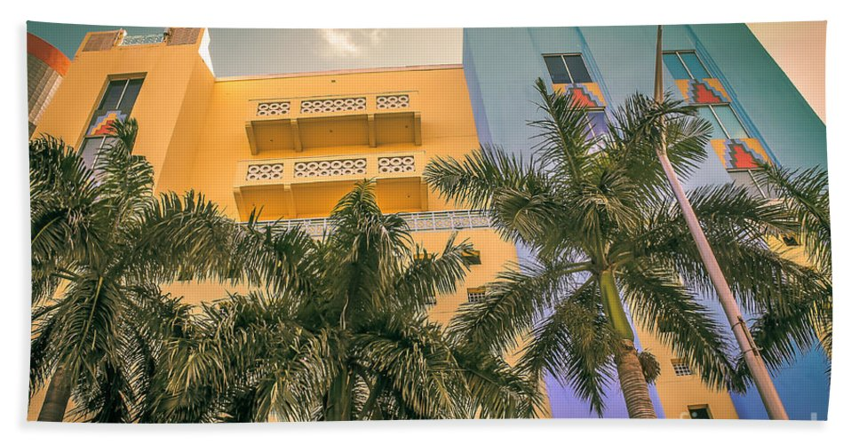 Florida Hand Towel featuring the photograph Colorful Building And Palm Trees by Claudia M Photography