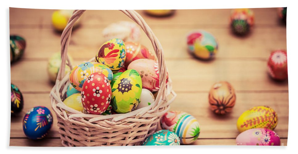 Easter Hand Towel featuring the photograph Colorful Hand Painted Easter Eggs In Basket And On Wood by Michal Bednarek