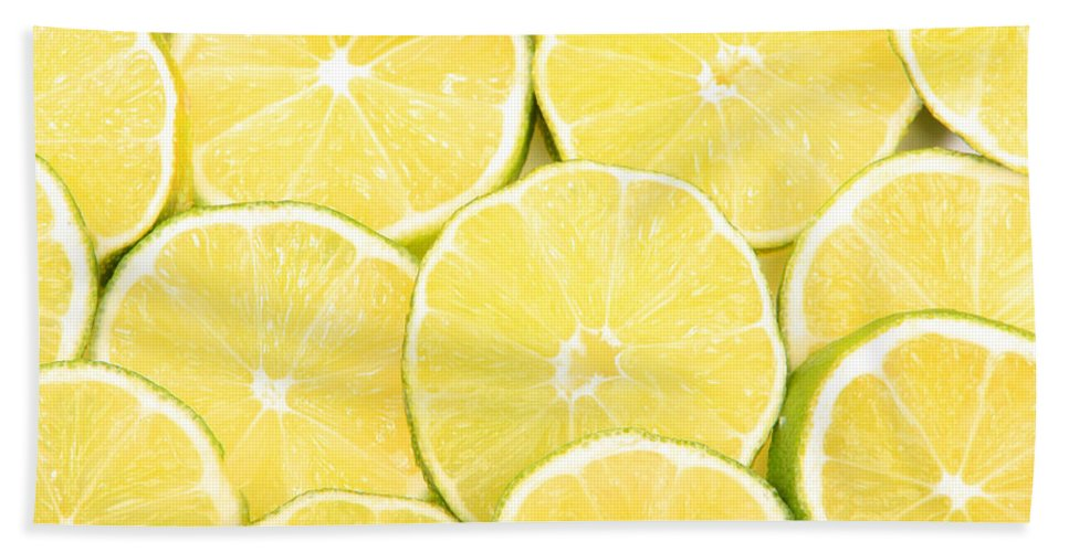 Citrus Bath Sheet featuring the photograph Colorful Limes by James BO Insogna