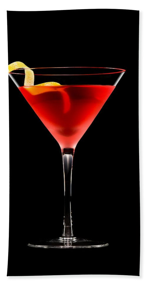 Alcohol Bath Sheet featuring the photograph Cosmopolitan Cocktail In Front Of A Black Background by U Schade