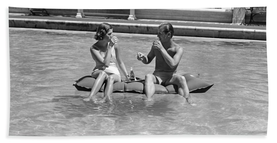 1930s Bath Sheet featuring the photograph Couple Relaxing In Pool, C.1930-40s by H Armstrong Roberts and ClassicStock