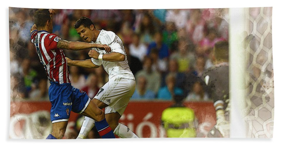 Uefa Chamipons League Bath Sheet featuring the digital art Cristiano Ronaldo Heads The Ball During The Spanish League Footb by Don Kuing