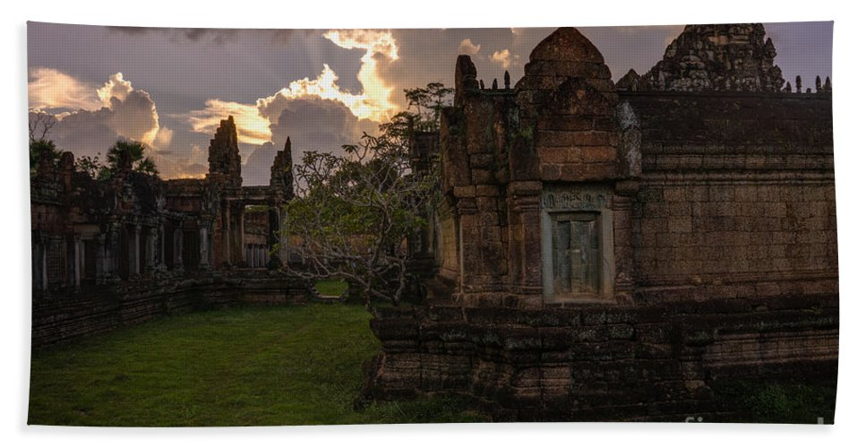 Sunrise Bath Sheet featuring the photograph Dark Cambodian Temple by Mike Reid