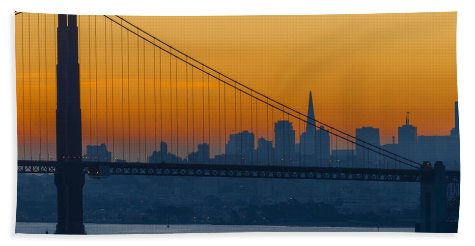 Beginning Hand Towel featuring the photograph Dawn Behind The Bridge by Jens Peermann