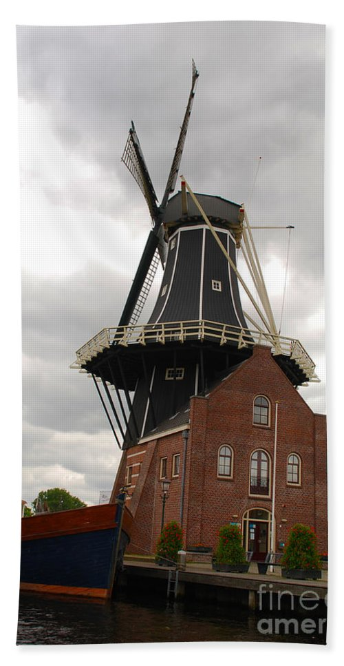 Holland Hand Towel featuring the photograph De Adriann Windmill - Haarlem The Netherlands by Just Eclectic