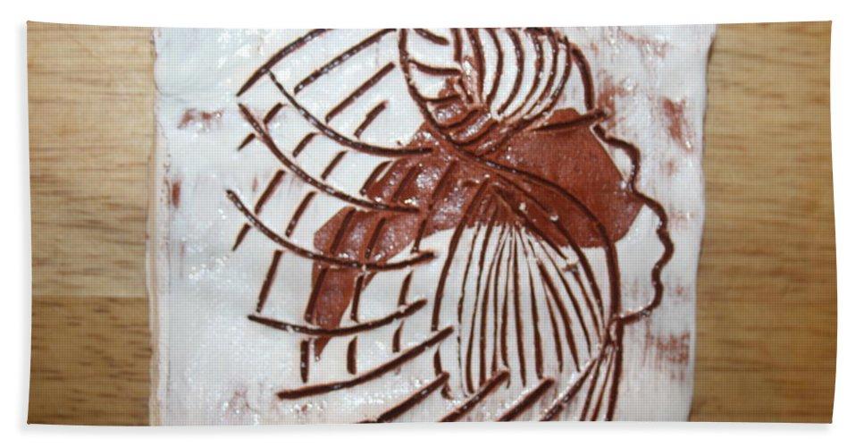 Jesus Hand Towel featuring the ceramic art Dean - Tile by Gloria Ssali