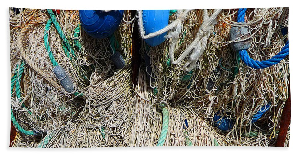 Fishing Net Bath Towel featuring the photograph Deep Blue Discs by Charles Stuart