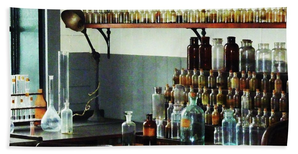 Flask Bath Sheet featuring the photograph Desk With Bottles Of Chemicals by Susan Savad