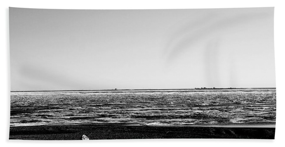 Landscape Hand Towel featuring the photograph Driftwood On Arctic Beach Balck And White by Anthony Jones