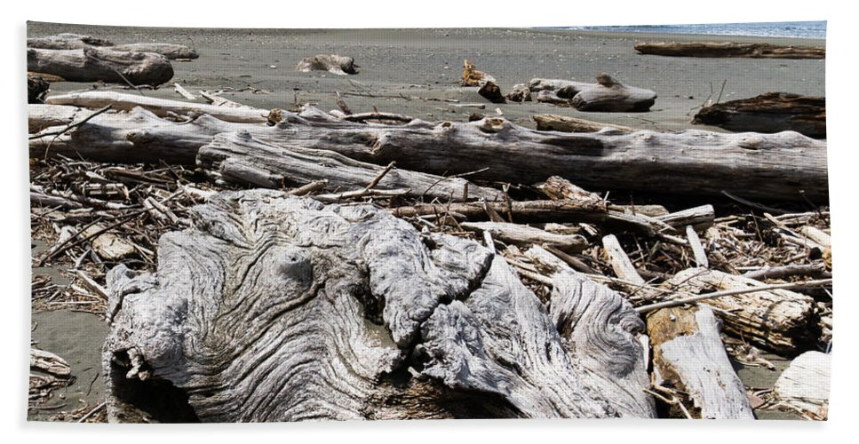 Beach Hand Towel featuring the photograph Driftwood On The Beach by John Trax