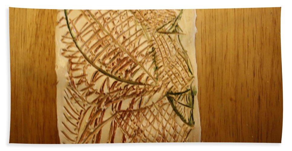Jesus Hand Towel featuring the ceramic art Emerald - Tile by Gloria Ssali
