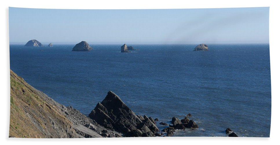 Oregon Hand Towel featuring the photograph Exposed Offshore Rocks by John Trax