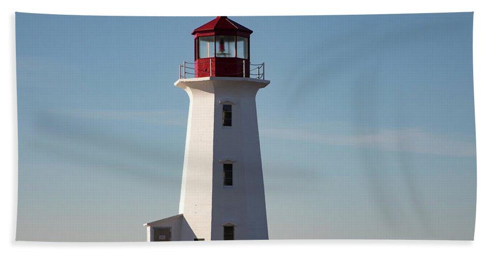 Attraction Bath Sheet featuring the photograph Exterior Of Peggys Cove Lighthouse, Nova Scotia, Canada by Karen Foley