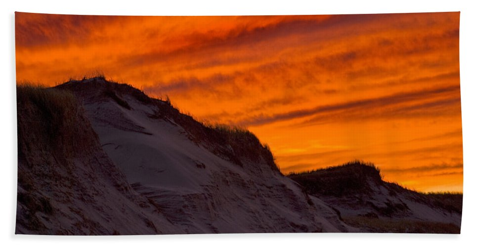 Fire Hand Towel featuring the photograph Fiery Sunset Over The Dunes by Charles Harden