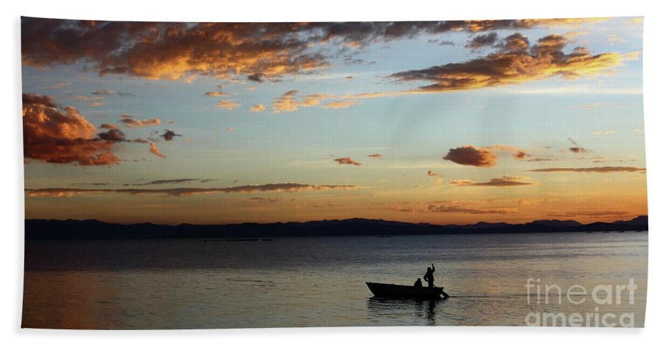 Peru Bath Sheet featuring the photograph Fishing At Sunset On Lake Titicaca by James Brunker
