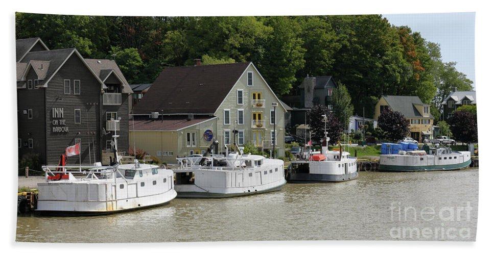 Fishing Boats Bath Sheet featuring the photograph Fishing Boats All In A Row by John Wijsman