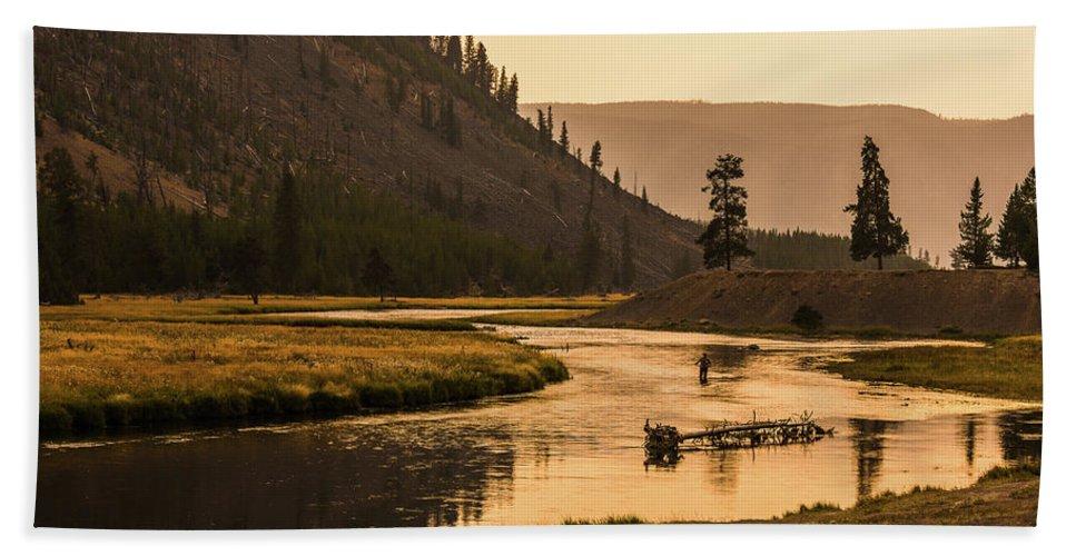 Fisherman Bath Sheet featuring the photograph Fishing On Smokey Madison River by Yeates Photography