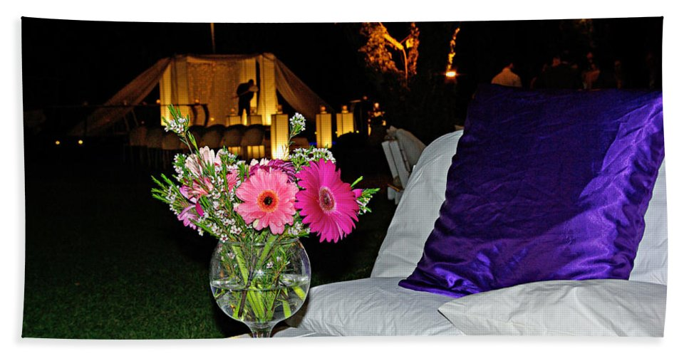 Flowers Bath Towel featuring the photograph Flowers In A Vase On A White Table by Zal Latzkovich