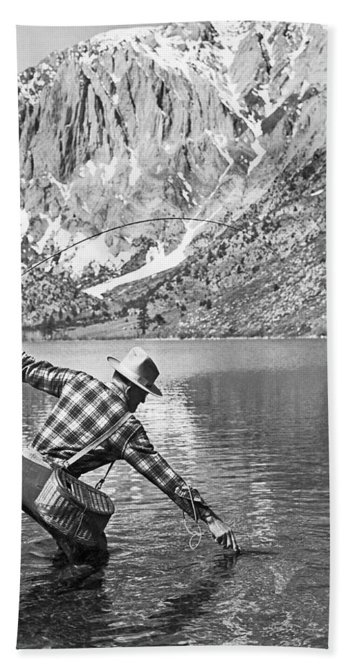 1 Person Hand Towel featuring the photograph Fly Fishing In A Mountain Lake by Underwood Archives