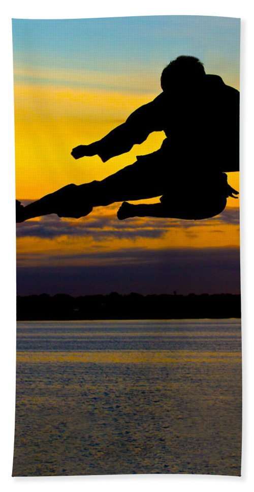Photography Hand Towel featuring the photograph Flying Kick Over Muskegon Lake by Frederic A Reinecke
