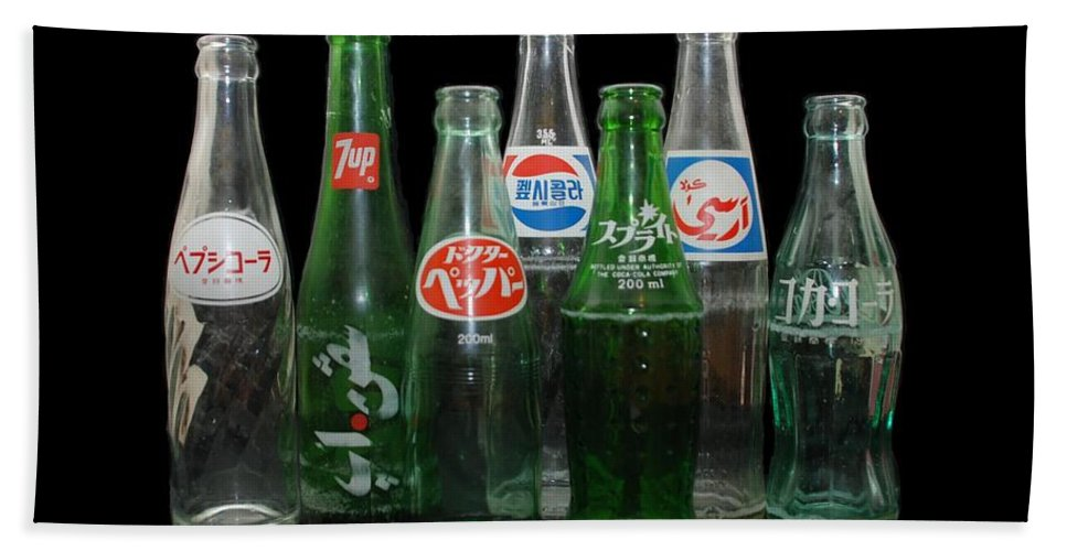 Pepsi Hand Towel featuring the photograph Foreign Cola Bottles by Rob Hans
