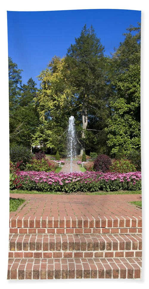 Garden Scene Hand Towel featuring the photograph Fountain Among Flowers by Sally Weigand
