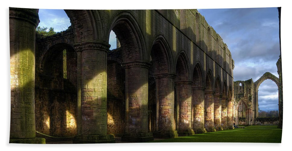 Castle Hand Towel featuring the photograph Fountains Abbey Shadows by Svetlana Sewell