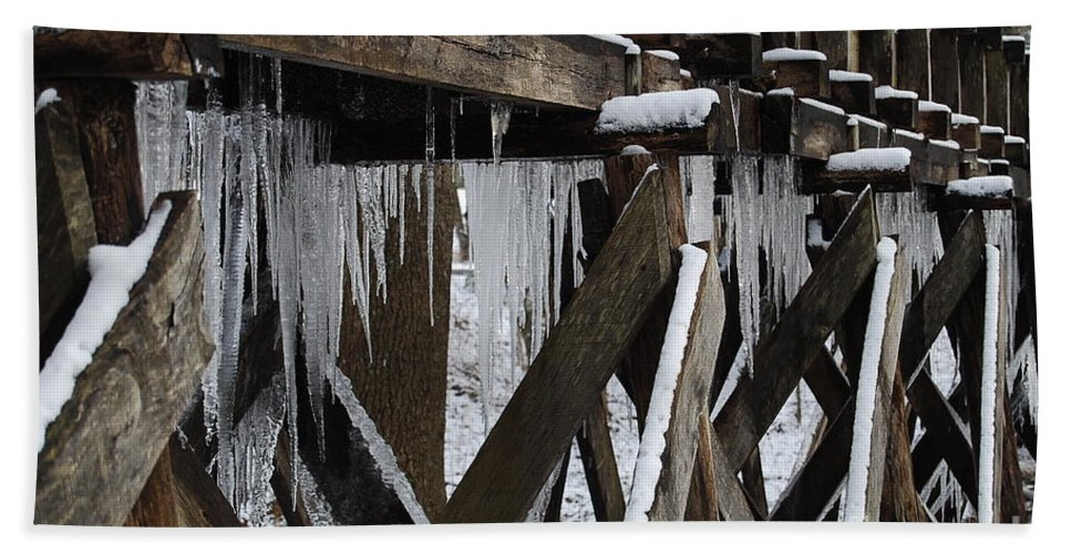Ice Hand Towel featuring the photograph Frozen Leaks by Eric Liller