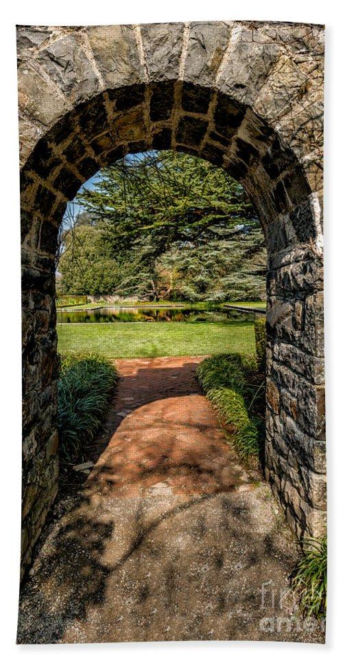 Garden Bath Towel featuring the photograph Garden Archway by Adrian Evans