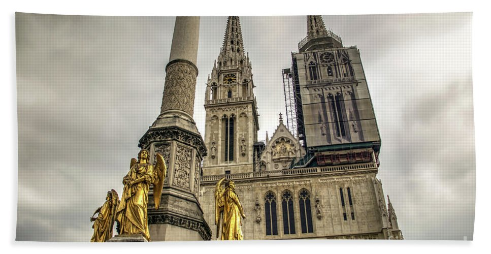 Angel Bath Sheet featuring the photograph Golden Angel Statues In Front Of The Cathedral by Bratislav Stefanovic