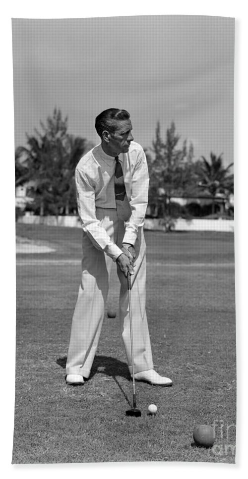 1930s Bath Sheet featuring the photograph Golfer Teeing Off, Miami, Florida by H. Armstrong Roberts/ClassicStock
