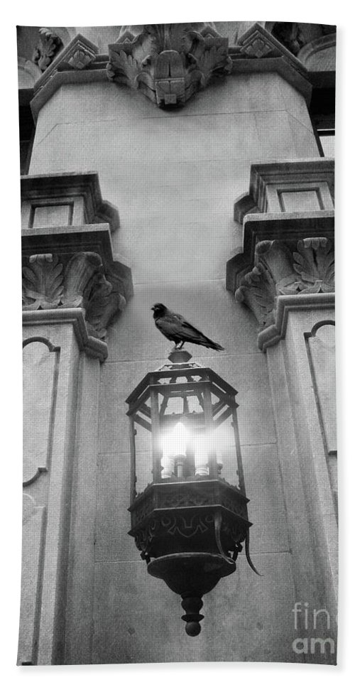 Raven Crow Art Hand Towel featuring the photograph Gothic Surreal Black White Raven On Lantern Lamp Post by Kathy Fornal