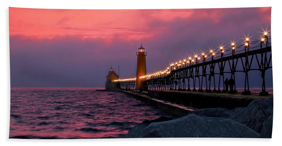 Grand Haven Hand Towel featuring the photograph Grand Haven Sunset by Susan Rissi Tregoning