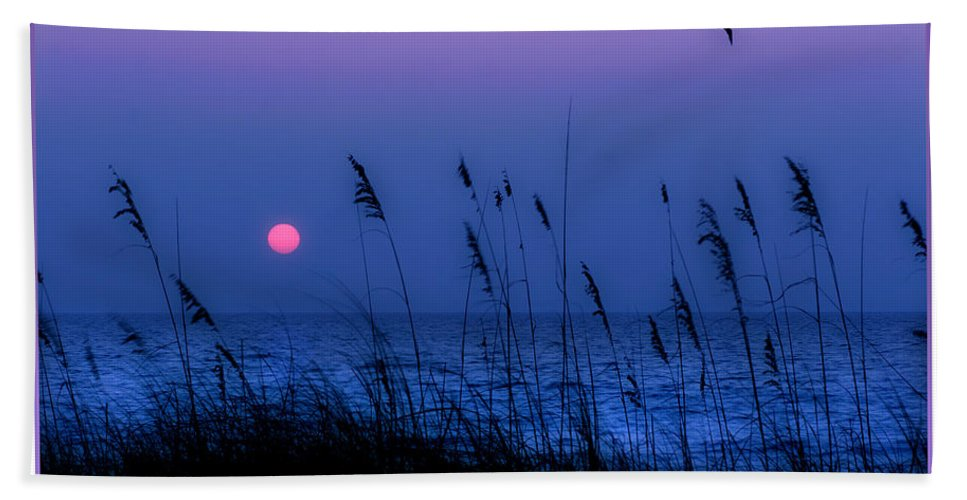 Grass Hand Towel featuring the photograph Grasses Frame The Setting Sun In Florida by Mal Bray