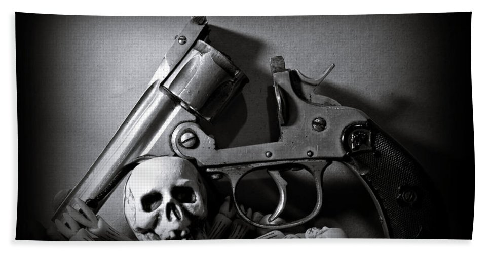 Black And White Bath Towel featuring the photograph Gun And Skull by Scott Wyatt