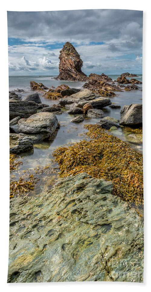 Sea Hand Towel featuring the photograph Gwenfaens Rock by Adrian Evans