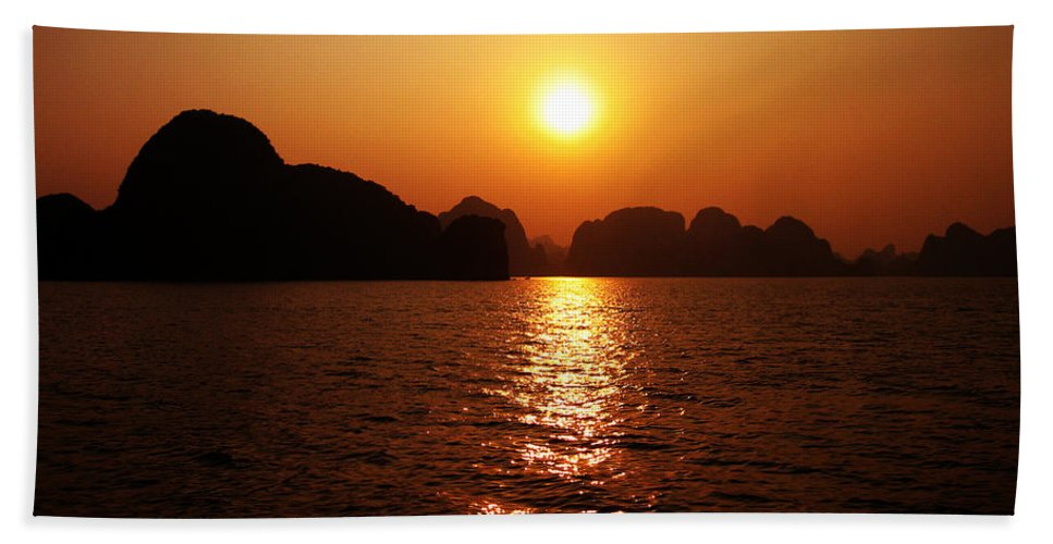 Orange Hand Towel featuring the photograph Ha Long Bay Sunset by Oliver Johnston