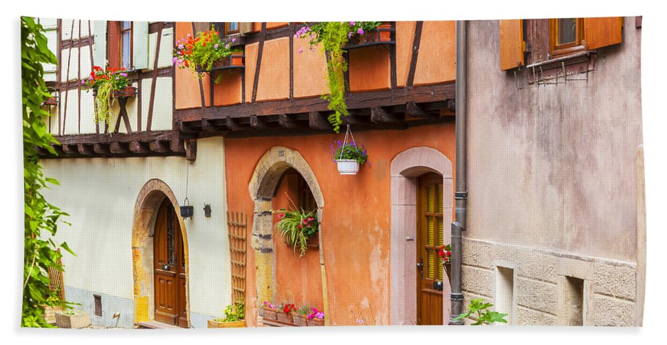 Alsace Hand Towel featuring the photograph Half-timbered House Of Eguisheim, Alsace, France. by Marco Arduino