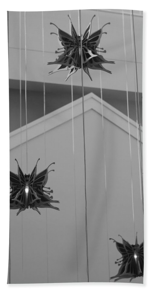 Architecture Bath Towel featuring the photograph Hanging Butterflies by Rob Hans