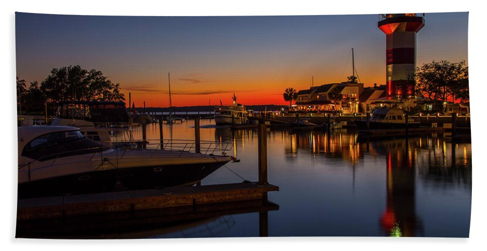 Harbour Town Lighthouse Bath Sheet featuring the photograph Harbour Town Lighthouse Sunset by Cliff Middlebrook