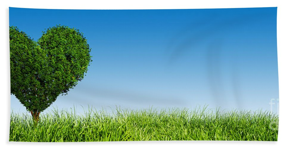 Tree Bath Sheet featuring the photograph Heart Shape Tree On Green Grass Field by Michal Bednarek