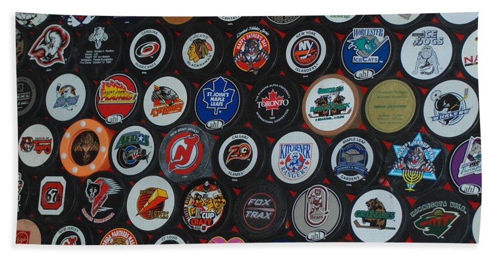 Pop Art Bath Towel featuring the photograph Hockey Pucks by Rob Hans