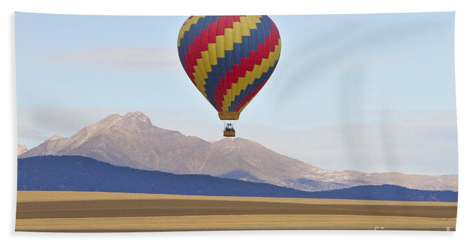 'hot Air Balloon' Hand Towel featuring the photograph Hot Air Balloon And Longs Peak by James BO Insogna