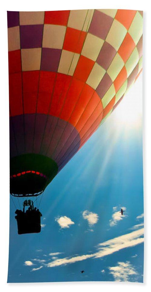 Hot Air Balloon Hand Towel featuring the photograph Hot Air Balloon Eclipsing The Sun by Bob Orsillo