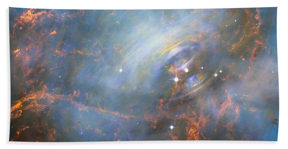 Crab Nebula Hand Towel featuring the photograph Hubble Captures The Beating Heart Of The Crab Nebula by Nasa